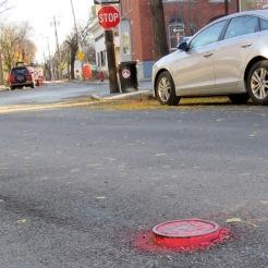 raised manhole, mid-street just before the Circle
