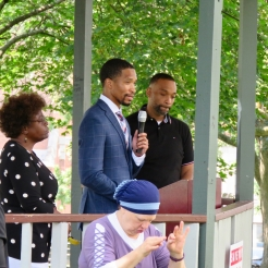 Marion Porterfield [L], Carl Williams (at podium), and Dammoni Farley